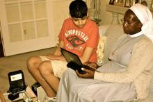 Prateek helping Hekima Girls School headmistress