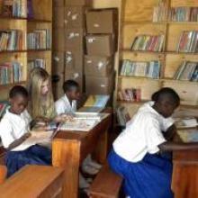 """Kangabusharo Primary School holds one of """"SHARE in Africa"""" 's libraries to further girls education"""